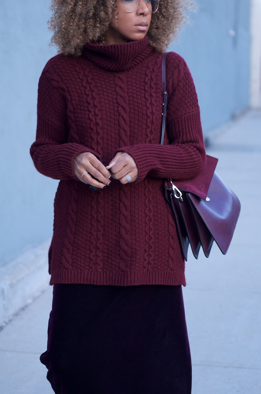 karen blanchard the fashion blogger with the Chloe faye bag in dark purple and cable knit sweater and clear aviator glasses