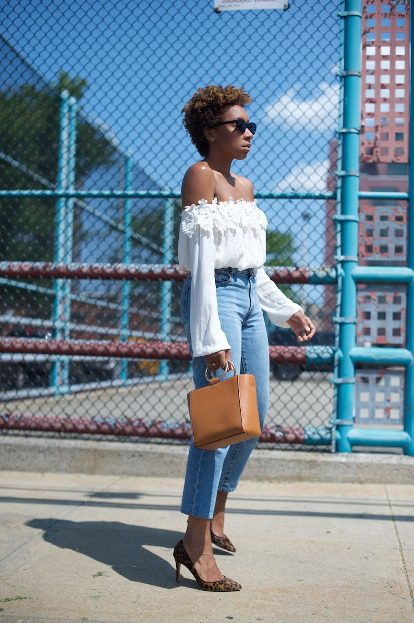 Karen Blanchard the youtuber and fashion blogger is wearing a River Island off the shoulder top and high waist jeans
