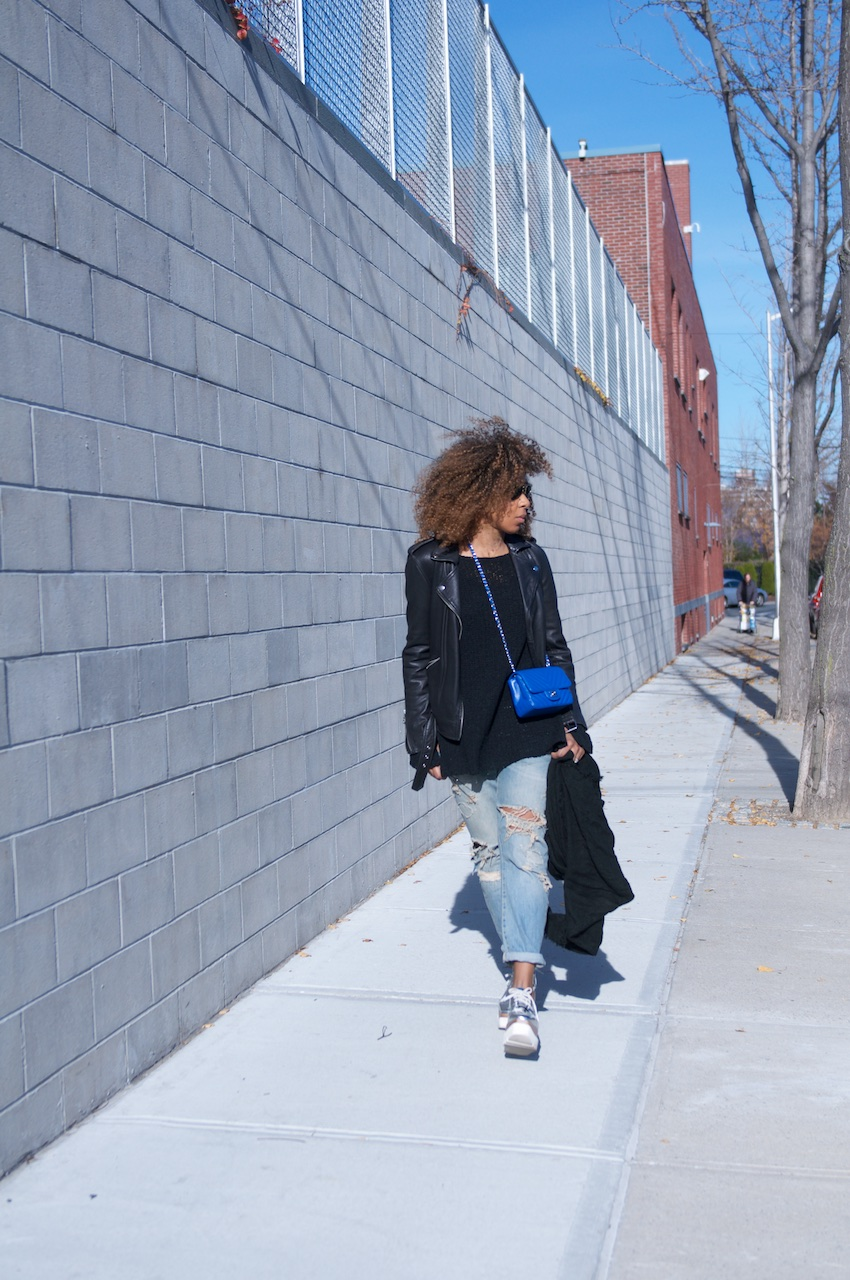 Fashion blogger karen blanchard wearing a Lucky Brand black leather jacket with Stella McCartney platform shoes and zara boyfriend jeans