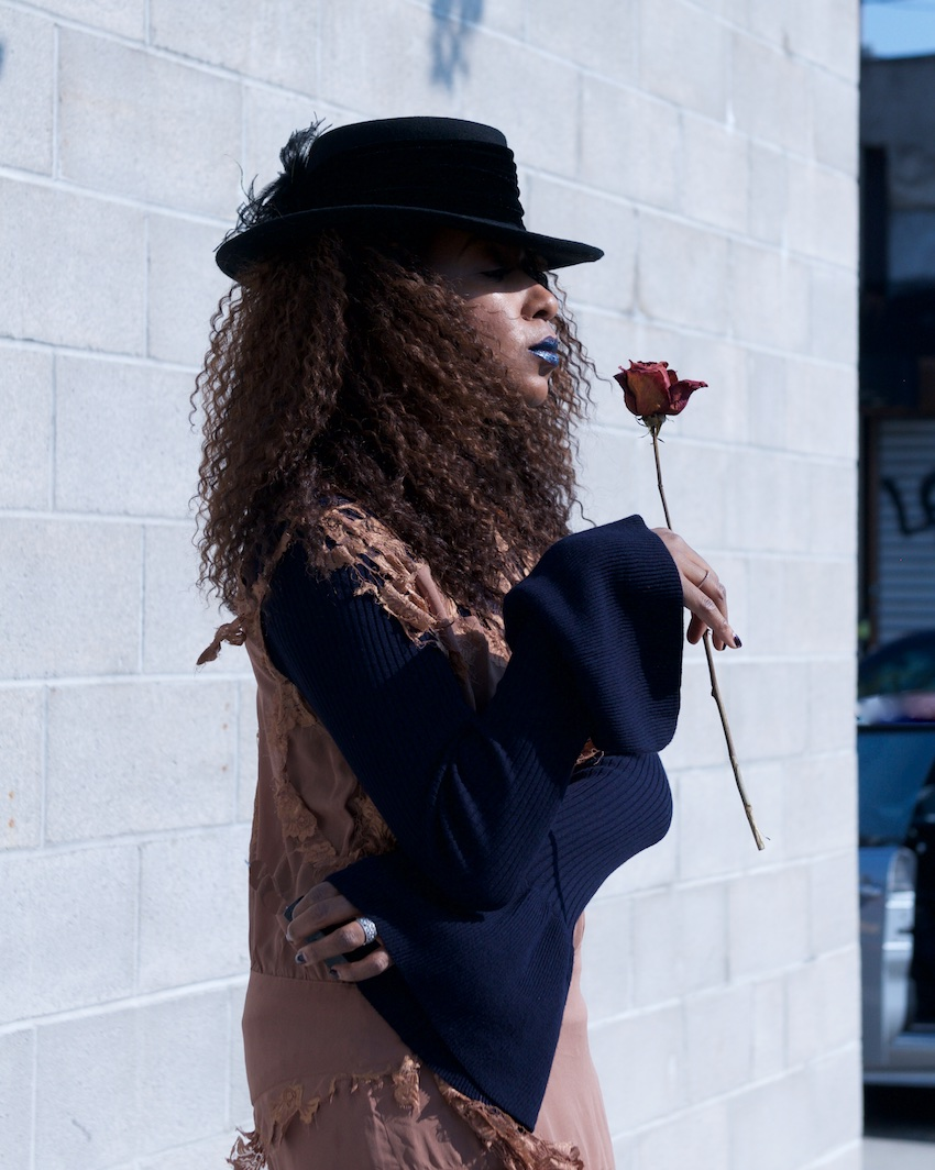 bell sleeve knit top and fedora with NYX dark nebula metal lipstick