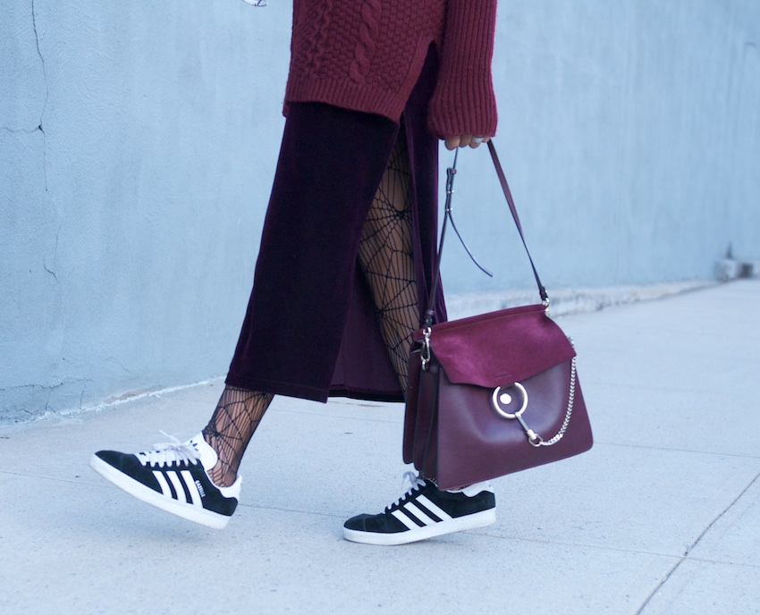 karen blanchard carrying the chloe faye bag with adidas gazelle trainers and long velvet skirt