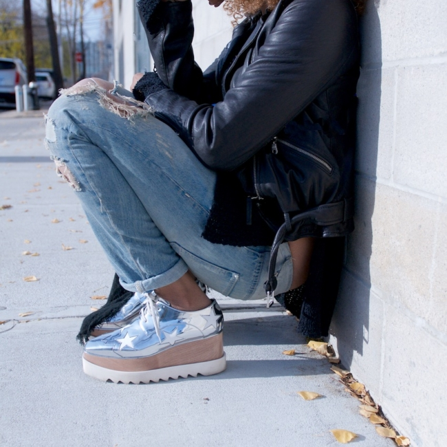 fashion blogger Karen Blanchard wearing stella mccartney platform shoes with a black leather jacket and ripped denim jeans