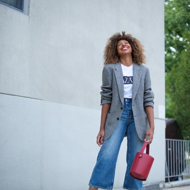 Karen Blanchard wearing zara wide leg jeans and a grey checked blazer