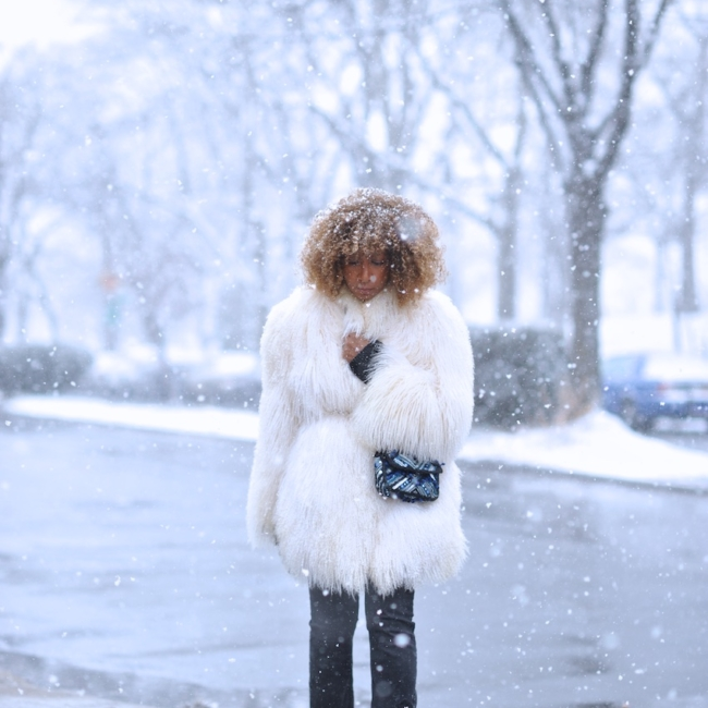 Karen Blanchard the fashion blogger wearing a mongolian fur coat and free people snake print boots