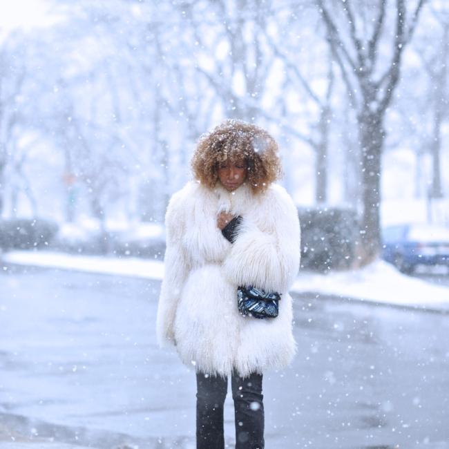 Karen Blanchard the fashion blogger wearing a mongolian fur coat and free people snake print boots
