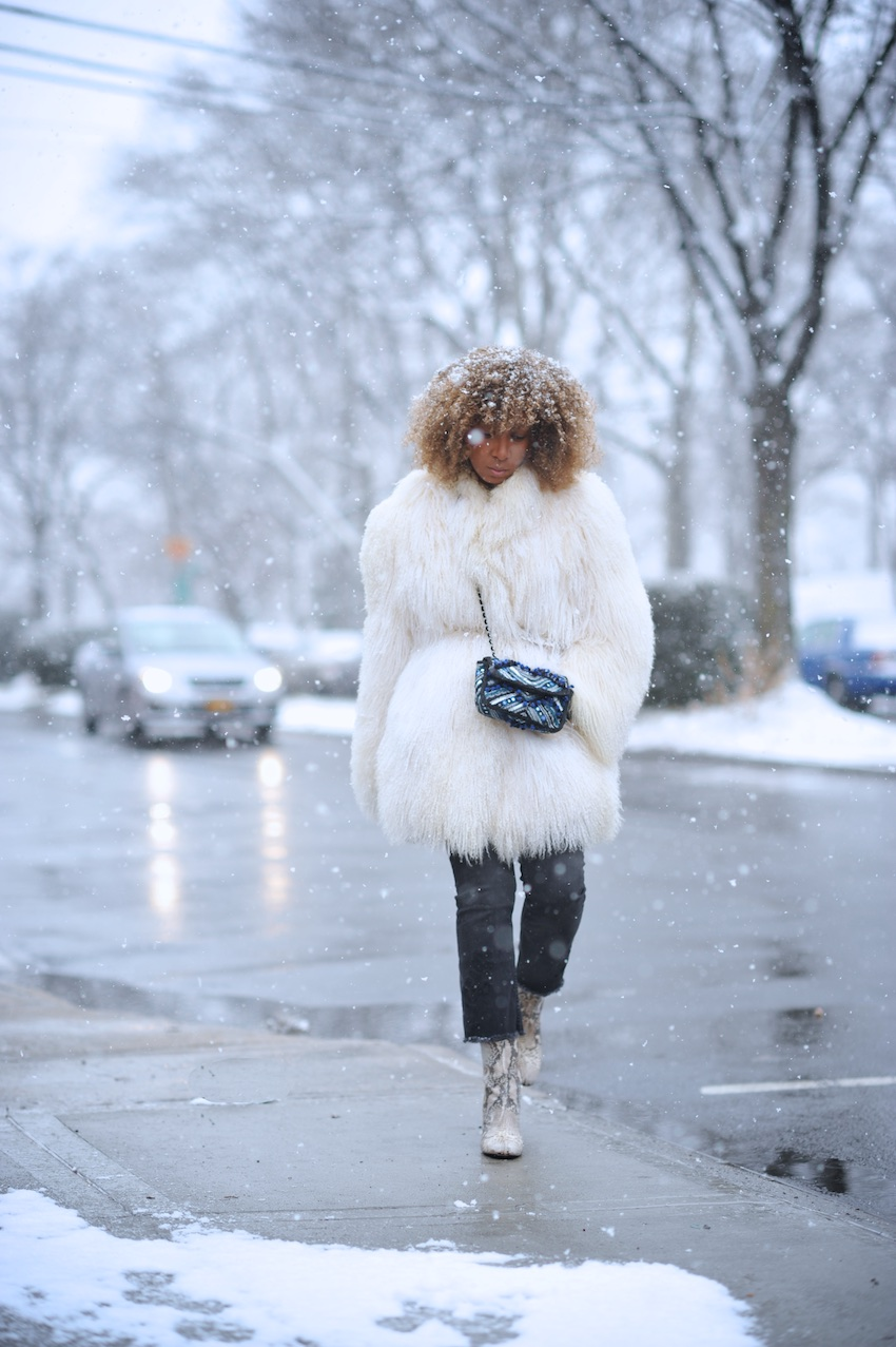 Karen Blanchard wearing a mongolian fur coat and Free People snake print ankle boots with black cropped jeans