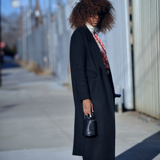 Karen Blanchard wearing a black H&M coat with zara red suede bow ankle boots and cropped levi jeans