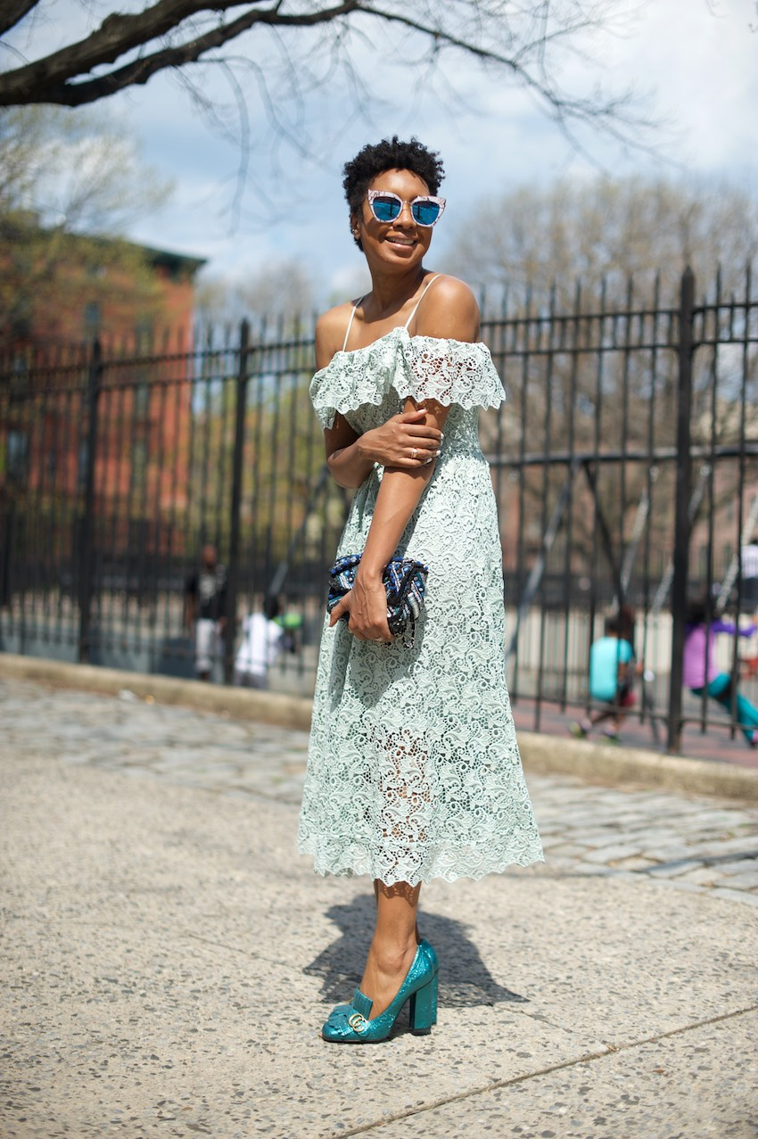 Karen Blanchard the black fashion blogger wearing an H&M off the shoulder lace dress with Gucci marmont heels and statement sunglasses