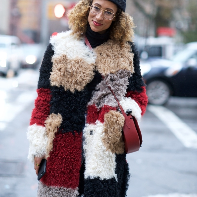 Elaine Welteroth wearing a patchwork fur coat
