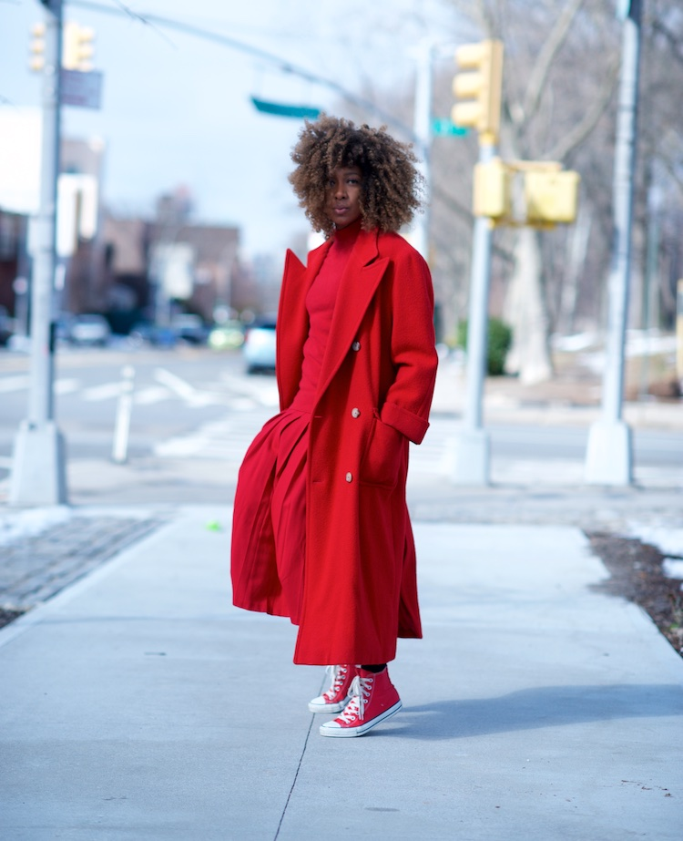 karen blanchard the fashion blogger wearing a red Ralph Lauren wool coat with a red pleated skirt and red converse sneakers