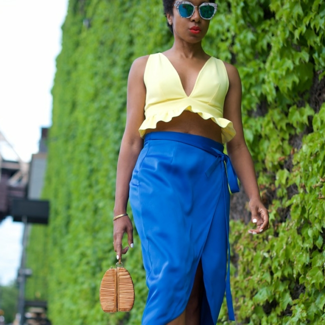 karen blanchard the fashion blogger wearing a yellow bralet top and satin skirt