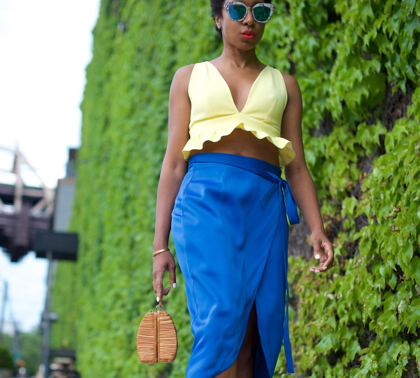 karen blanchard the fashion blogger wearing a yellow bralet top and satin skirt