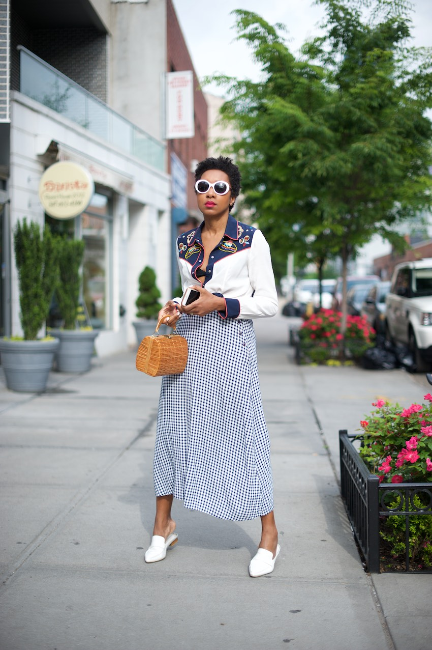 Karen Blanchard the fashion blogger and youtuber is wearing a vintage gingham skirt with a basket bag