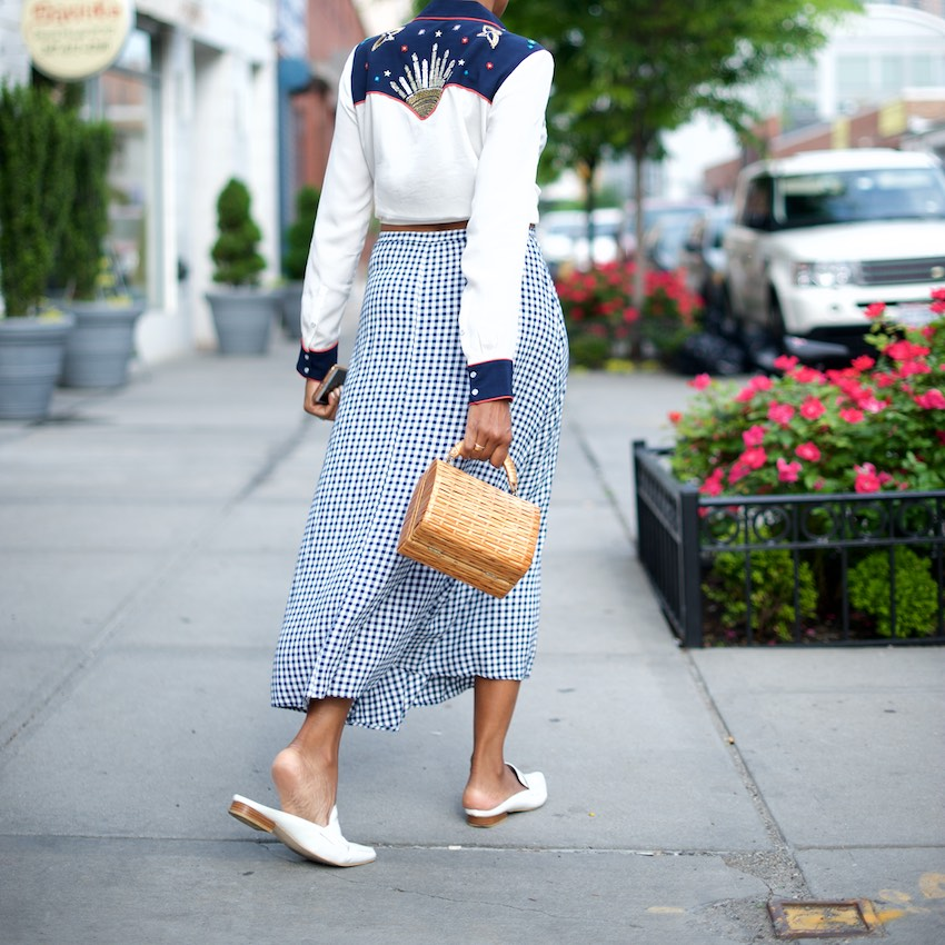 Karen Blanchard is wearing a gingham skirt with a beaded western style shirt and jeffrey campbell mules