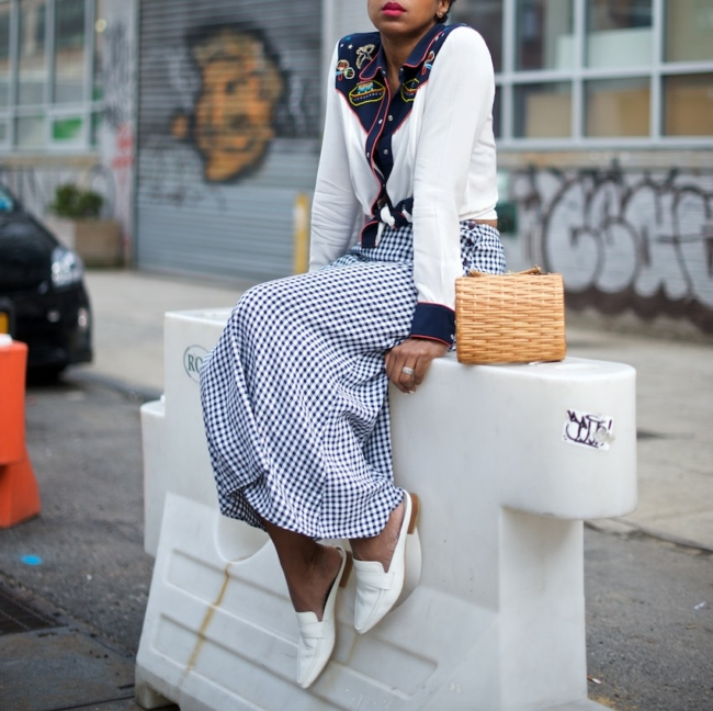 Karen Blanchard is wearing a gingham maxi skirt with a vintage wicker basket bag and white mules