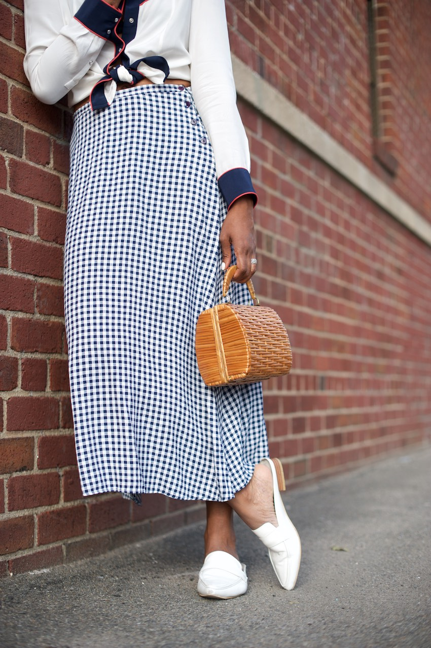 Karen Blanchard is carrying a vintage basket bag and a vintage gingham skirt
