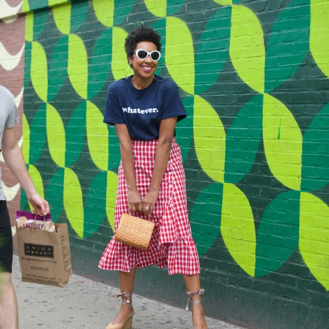 Karen Blanchard is wearing white sunglasses with a gingham ruffle skirt and Castaner espadrilles