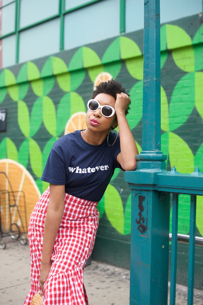 Karen Blanchard the black fashion blogger is wearing a red gingham ruffle skirt with white sunglasses