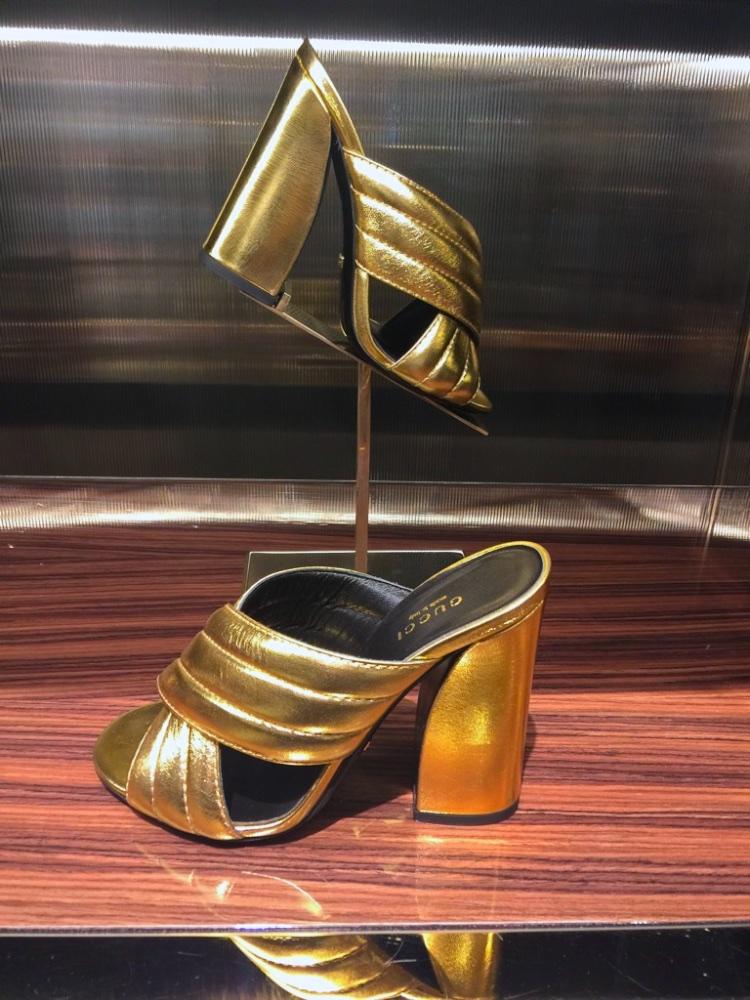 Gucci gold mules